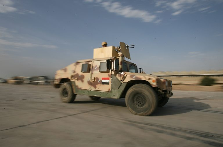 Iraqi soldiers drive on one of their new armored humvees.  The Iraq's 2nd Brigade, 1st Iraqi Division took delivery of 10 armored humvees, purchased by Iraq's Ministry of Defense.  The addition of humvees to the Iraqis boosts their protection level and ability to move throughout the Fallujah area.  Until now, they were entirely reliant on Nissan pick-up trucks with armor added.