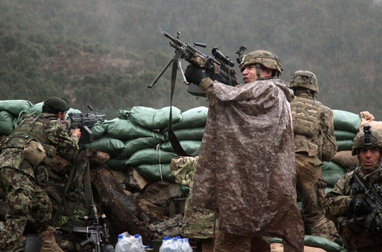 110329-A-TH742-245       A U.S. Army soldier with the 101st Airborne Division returns fire with a M249 light machine gun during combat operations in the valley of Barawala Kalet, Kunar province, Afghanistan, on March 29, 2011.  DoD photo by Pfc. Cameron Boyd, U.S. Army.  (Released)