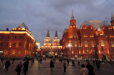 people-walking-around-the-square-at-night-in-moscow-russia