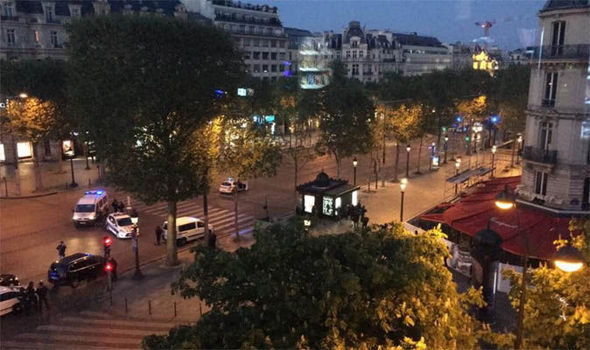 Paris shooting: police officer killed and two injured