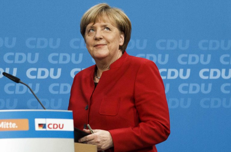 German Chancellor Angela Merkel arrives at a news conference where she announced her plan to run for a fourth term next year. Merkel is the leader of the conservative German Christian Democrats party.