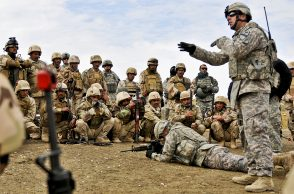 U.S. Army Sgt. Kevin Murphy, 1st Squadron, 9th Cavalry Regiment, 4th Advise and Assist Brigade, 1st Cavalry Division, instructs Iraqi soldiers on individual movement techniques during a class at teh Ghuzlani Warrior Training Center, Feb. 2. The trainees, from 2nd Battalion, 11th Brigade, 3rd Iraqi Army Division, began their 25-day training cycle at GWTC with individual and squad level training. (U.S. Army photo by Sgt. Shawn Miller)